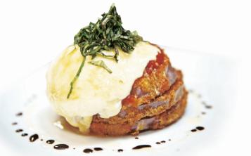 Berenjena a la parmesana, uno de los platos de Arborio. (Archivo)