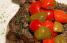 """Rib Eye servido con """"cherry pepperscala"""" rostizados, uno de los muchos platos exquisitos de Ruth's Chris. (Archivo)"""